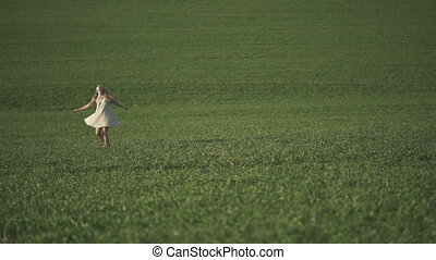 Carefree adorable girl in field