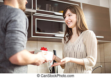 Housewife receiving a present from her husband