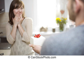 Man giving woman gift for her birthday