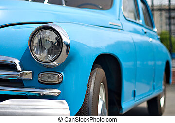 blue retro car - view from front side, headlamp and bumper