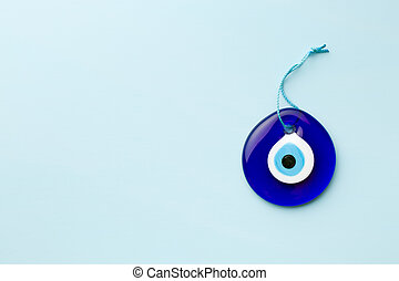 blue turkish eye on blue background