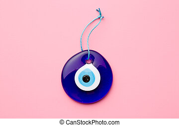 blue turkish eye on pink background