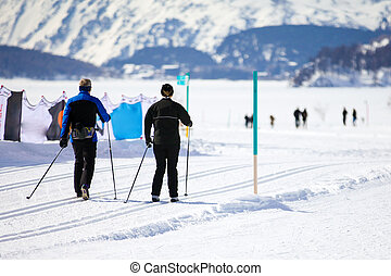 Couple Cross Country Skiing in Engadin, Switzerland