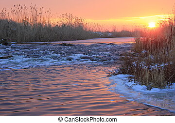 Dawn over Rushing winter river