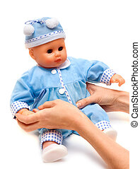 Nursery doll in blue suit on white background