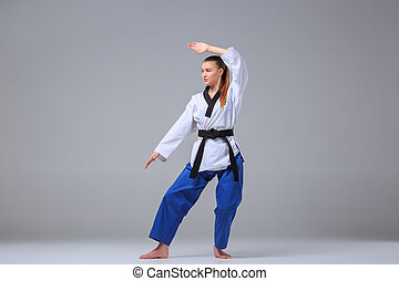The karate girl with black belt - The karate girl in white...