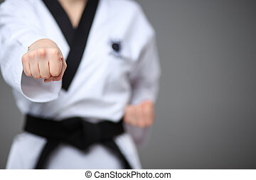 The karate girl with black belt - The hand of karate girl in...