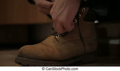 man clothes and tying his shoes - man clothes and tying his...