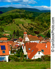 Tilt-shift view of classic french village, red roofs on the...