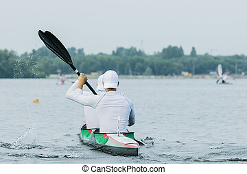 two athlete in a kayak