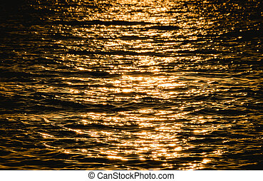 Sea wave on yellow color at sunset time