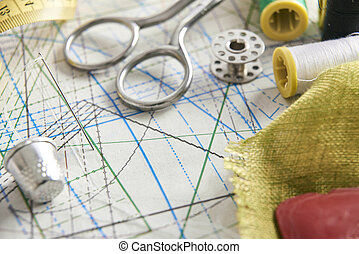Tailoring tools on clothing pattern elevated view -...