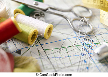 Tailoring tools on clothing pattern elevated view close up -...