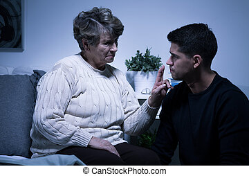 Young man and grandmother - Silence between young man and...