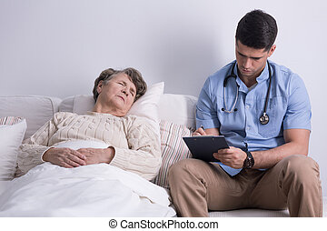Doctors home visit - Older woman and her doctors home visit...