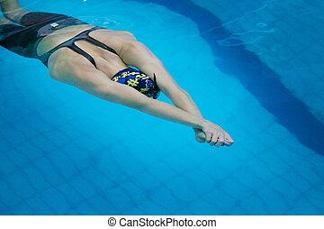 girl athlete in swimming start
