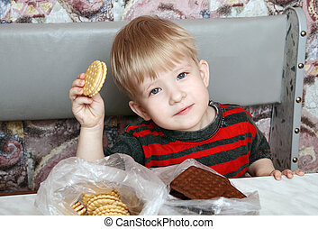 Pleased with the child with cookies in hand