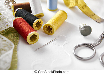 Sewing tools on fabric background elevated view - Sewing...