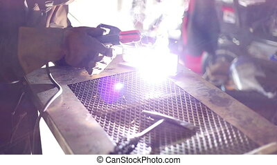 Welding on metal bench