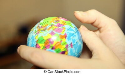 small globe in the hands of women, HD