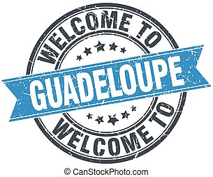 welcome to Guadeloupe blue round vintage stamp