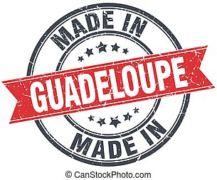 made in Guadeloupe red round vintage stamp