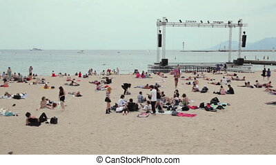 People relax on Cannes beach - Cannes beach, people relaxing...
