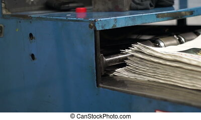 Offset Press Newspapers Stacking - Newspapers coming off the...
