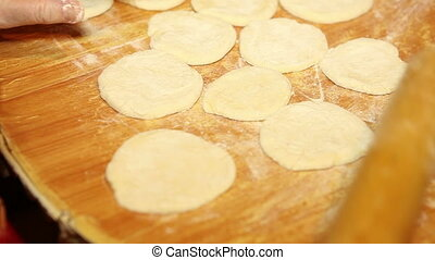 womens hands rolled dough for dumplings, close-up, HD