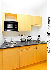 Practical kitchen for small space in studio apartment