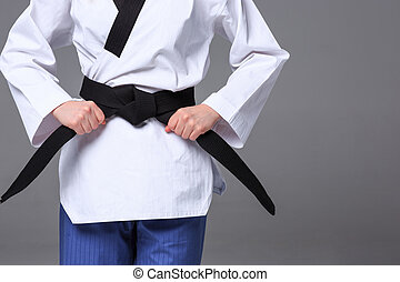 The karate girl with black belt - The hands of karate girl...