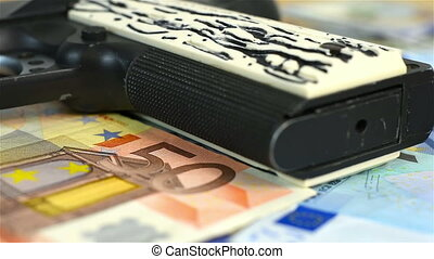 gun on euro bills - black gun he is lying on euro bills
