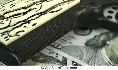 gun on dollar bills - black gun he is lying on dollar bills
