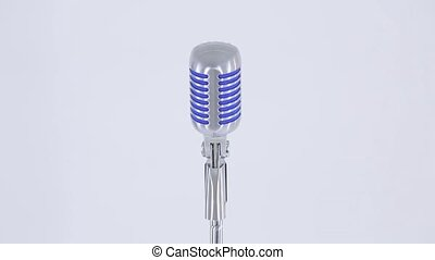 Man holding a microphone on a white background