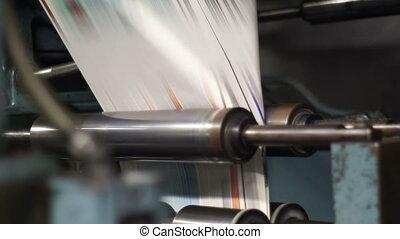 Offset Press Paper Folder Fast - Handheld shot of fast...