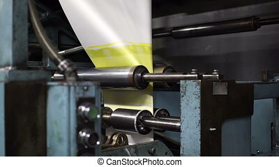Offset Press Paper Folder Slow - Close up shot of a...