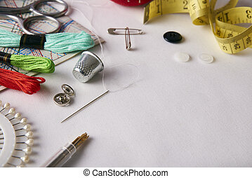 Composition tools for embroidery on white fabric elevated...