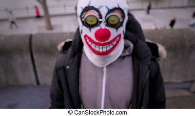 Man with a clown mask, river Thames - Man with a clown mask...