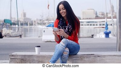 Relaxed confident young woman on a mobile - Relaxed...
