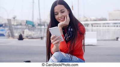 Attractive woman reading a text message - Attractive woman...