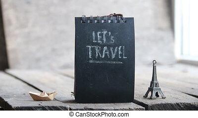 Let's travel inscription - Let's travel lettering on a black...