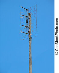 Old TV antenna over blue sky