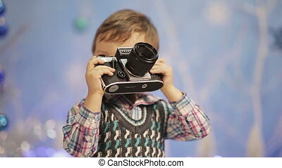Little boy with old camera - Little boy with an old camera...