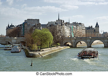 Cite island, sunny spring day in Paris - Pleasure boat with...