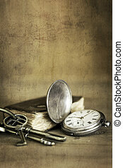 Vintage Grunge Still Life with Pocket Watch Old Book and Brass Keys