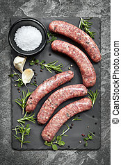 Raw Sausages on Slate Overhead View - Raw sausages on slate,...