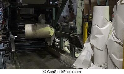 Industrial Offset Press Paper Rolls - Tilt up shot of the...