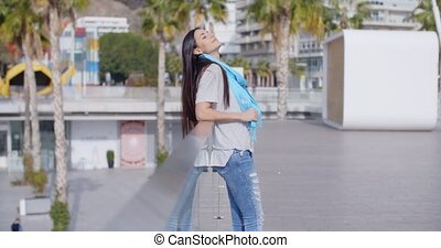 Smiling woman looking back over railing - Single beautiful...