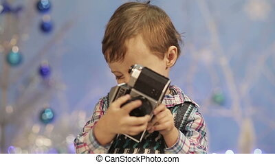 Little boy with old camera