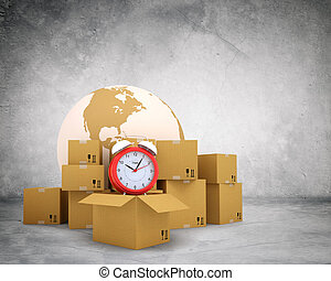 Alarm clock on stack of boxes
